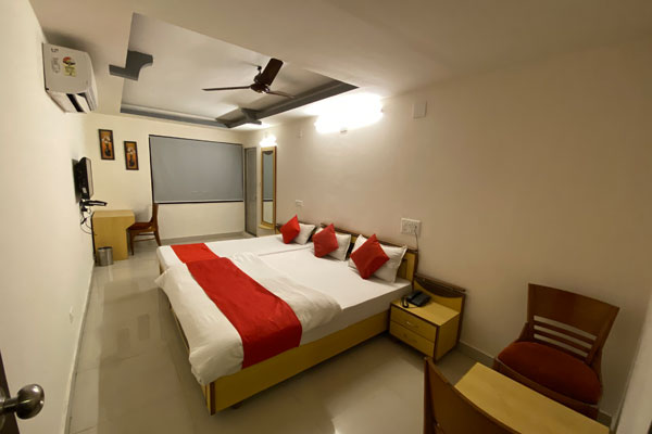 Triple Bed Room, Hotel Riverfront - Budget Hotels in Ahmedabad